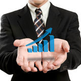 Businessman holding glowing graph Royalty Free Stock Image