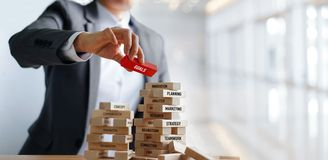 Businessman holding GOALS word on wooden blocks. Financial royalty free stock photos