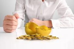 Businessman Holding  Golden Eggs Royalty Free Stock Image