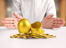 Businessman Holding  Golden Eggs Royalty Free Stock Photo