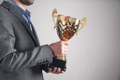 Businessman holding golden trophy. Business, Success royalty free stock images