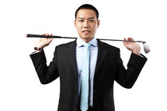 Businessman holding the golf iron Royalty Free Stock Photo
