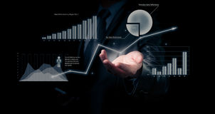 Businessman holding graph Stock Images
