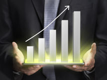 Businessman holding a graph showing growth. Close up Stock Images