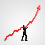 Businessman holding graph Stock Photo