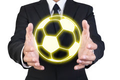 Businessman holding graphic gold football Stock Photography