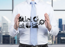 Businessman holding graphs Royalty Free Stock Photo