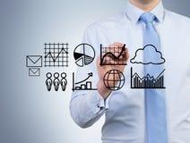Businessman holding graphs Stock Image