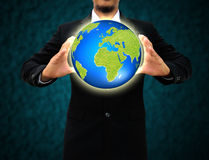 Businessman holding green Earth in hands Royalty Free Stock Images