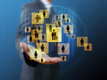 Businessman holding a group of business people Royalty Free Stock Image