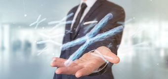 Businessman holding a Group of chromosome with DNA inside isolated on a background 3d rendering. View of a Businessman holding a Group of chromosome with DNA royalty free stock photo