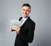 Businessman holding group of dollar bills Royalty Free Stock Images