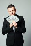 Businessman holding group of dollar bills Royalty Free Stock Photo
