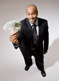 Businessman holding group of twenties Stock Photos