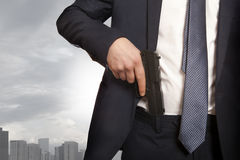 Businessman holding a gun Royalty Free Stock Image