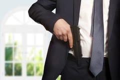 Businessman holding a gun Stock Photo