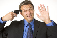 Businessman Holding Gun To His Head While Smiling Stock Photo