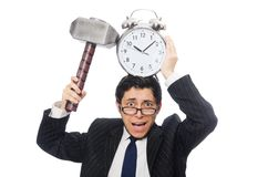 Businessman holding hammer and alarm clock Stock Photography