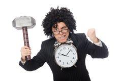 Businessman holding hammer and alarm clock Royalty Free Stock Photos