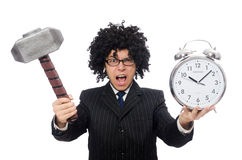 Businessman holding hammer and alarm clock Stock Images