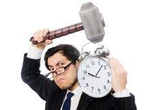 Businessman holding hammer and alarm clock Stock Photos