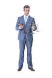 Businessman holding hammer and balance Royalty Free Stock Image