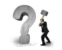Businessman holding hammer cracked question mark isolated on whi Stock Images