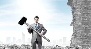 Businessman holding hammer Stock Photography