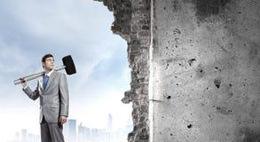 Businessman holding hammer Stock Photos
