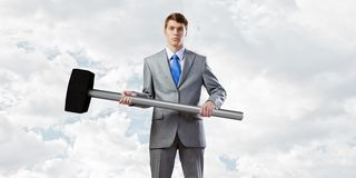 Businessman holding hammer Stock Photos