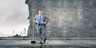 Businessman holding hammer Stock Image