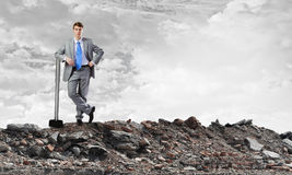 Businessman holding hammer Royalty Free Stock Images