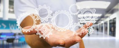Businessman holding hand-drawn gears icons Royalty Free Stock Photography