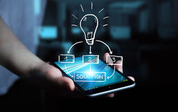 Businessman holding hand drawn lightbulb. Over his mobile phone Royalty Free Stock Photo
