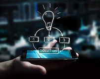 Businessman holding hand drawn lightbulb. Over his mobile phone Stock Images
