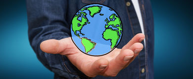 Businessman holding hand drawn planet earth Stock Photography
