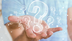 Businessman holding hand drawn question marks Stock Image