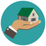 Businessman holding in hand a house. Isolated royalty free illustration