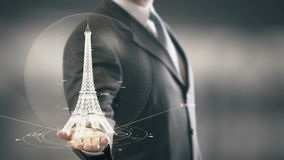 Businessman holding in Hand Landmark Eiffel Tower New technologies. Businessman in the future with futuristic technology with landmark stock footage