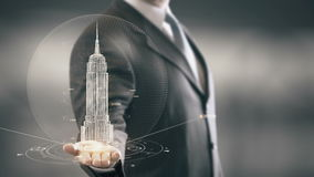 Businessman holding in Hand Landmark Empire State Building. New technologies. Businessman in the future with futuristic technology with landmark stock footage