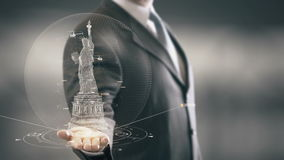 Businessman holding in Hand Landmark Statue of Liberty New technologies. Businessman in the future with futuristic technology with landmark stock footage