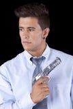 Businessman holding a handgun Royalty Free Stock Photography