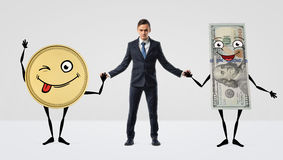 A businessman holding hands with large anthropomorphic golden coin and dollar bill. Royalty Free Stock Image
