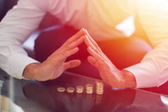 Businessman holding hands over growing coin columns Royalty Free Stock Photo