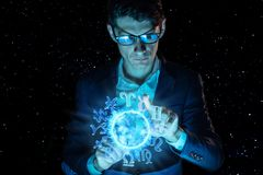 Businessman holding hands over the magic sphere with a horoscope to predict the future. Astrology as a business. Man businessman holding hands over the magic royalty free stock photography