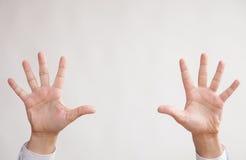 Businessman holding hands up Stock Photos