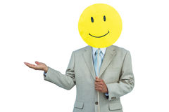 Businessman holding happy smiley face balloon. On white background royalty free stock image
