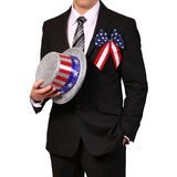 Businessman holding Hat with American Flag isolated Stock Photography