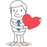 Businessman holding heart Royalty Free Stock Photography