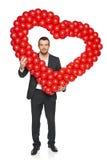 Businessman holding heart shape Stock Photography